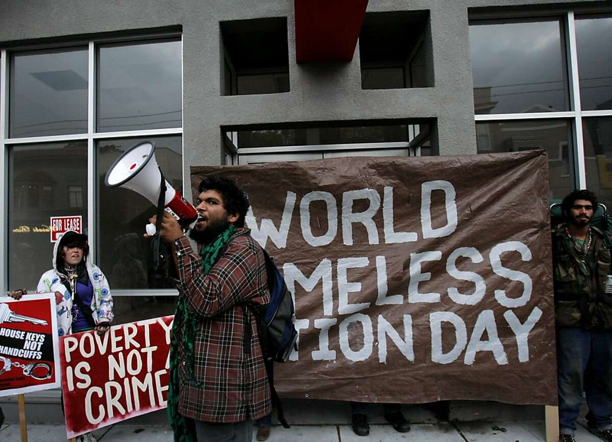 In the Castro district, protesters chant in front of a vacant building they took over to mark World Homeless Action Day. Police officers later moved in and arrested 20 demonstrators.