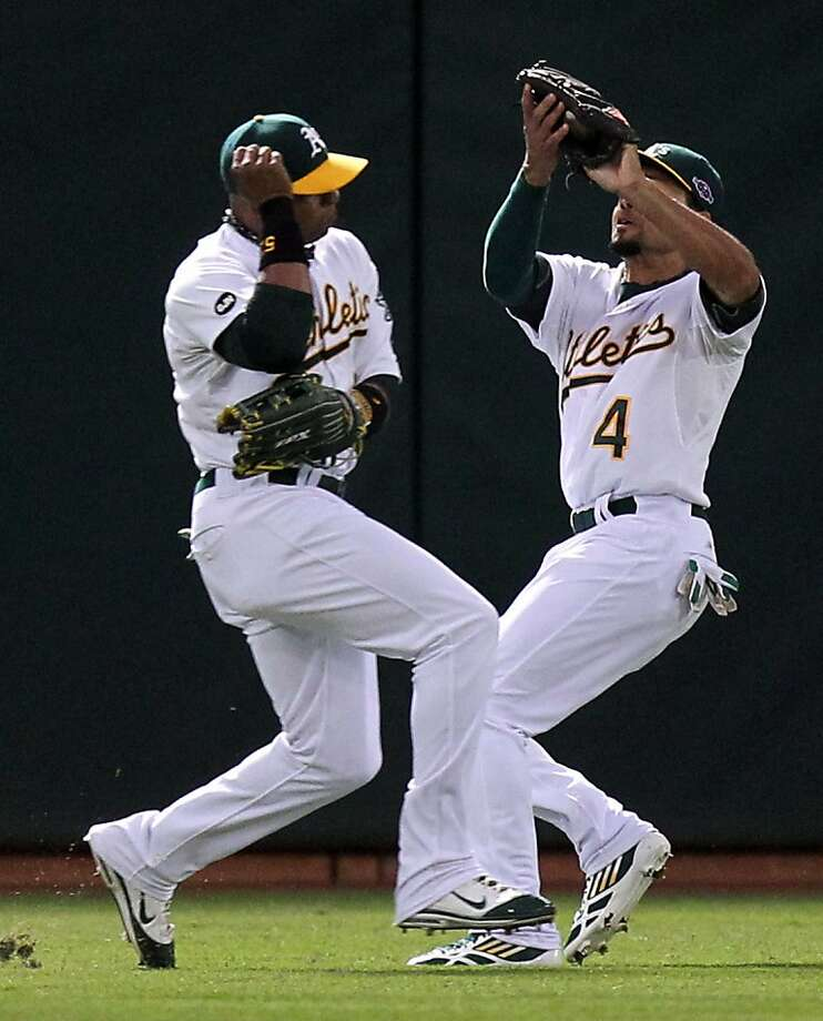 Yoenis Céspedes (left) and Coco Crisp will split outfield time with Josh Reddick, Chris Young and, on occasion, Seth Smith. Photo: Lance Iversen, The Chronicle