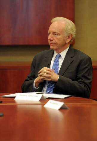 "Senator Joseph Lieberman speaks at AmeriCares in Stamford on Wednesday, October 10, 2012, where he presented the organization with a ""Joe's Hero"" award. Photo: Lindsay Niegelberg / Stamford Advocate"