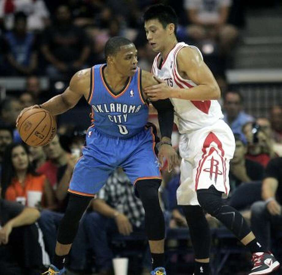 Houston Rockets' Jeremy Lin defends Oklahoma City Thunder's Russell Westbrook (0) during the second quarter of an NBA preseason basketball game, Wednesday, Oct. 10, 2012, in Hidalgo, Texas. The Thunder won 107-103. (AP Photo/Delcia Lopez) (Associated Press)