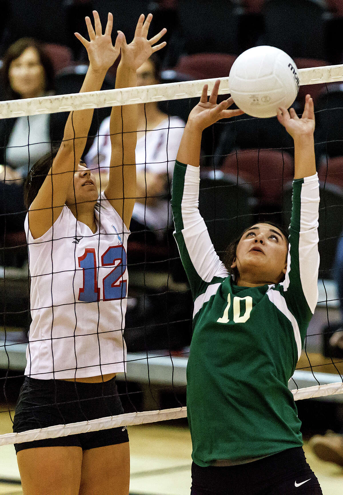 Incarnate Word's Lauren Guerra (right) sets the ball at the net as Antonian's Aly Gorday defens during their match at the McDermott Center on Oct. 10, 2012. Incarnate Word won the match 25-18, 25-15, 25-18. MARVIN PFEIFFER/ mpfeiffer@express-news.net