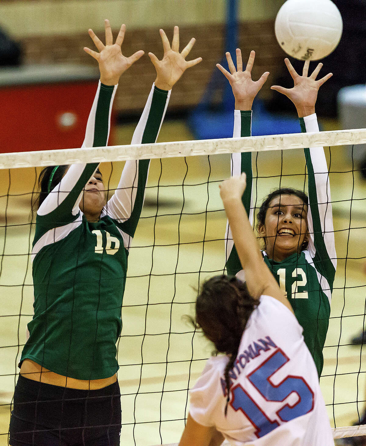 Incarnate Word's Theresa Reyna (left) and Ana Hurtado try to block a shot by Antonian's Haley Hall during their match at the McDermott Center on Oct. 10, 2012. Incarnate Word won the match 25-18, 25-15, 25-18. MARVIN PFEIFFER/ mpfeiffer@express-news.net