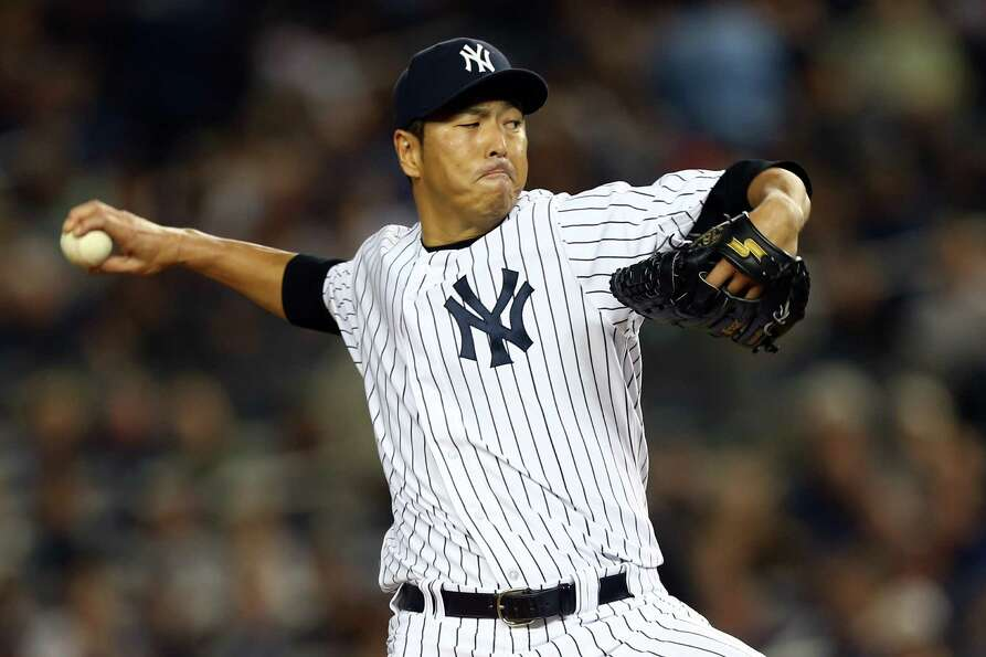 NEW YORK, NY - OCTOBER 10: Hiroki Kuroda #18 of the New York Yankees pitches during Game Three of th