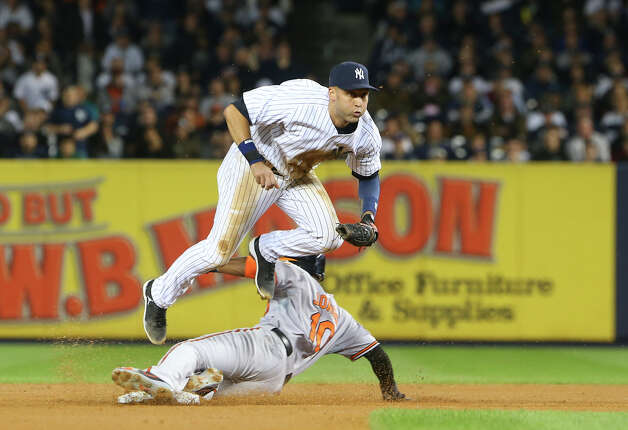 New York Yankees short stop Derek Jeter forces out Baltimore Orioles center fielder Adam Jones during game three of the American League Division Series at Yankee Stadium in New York, Oct. 10, 2012. (Chang W. Lee/The New York Times) Photo: CHANG W. LEE / NYTNS