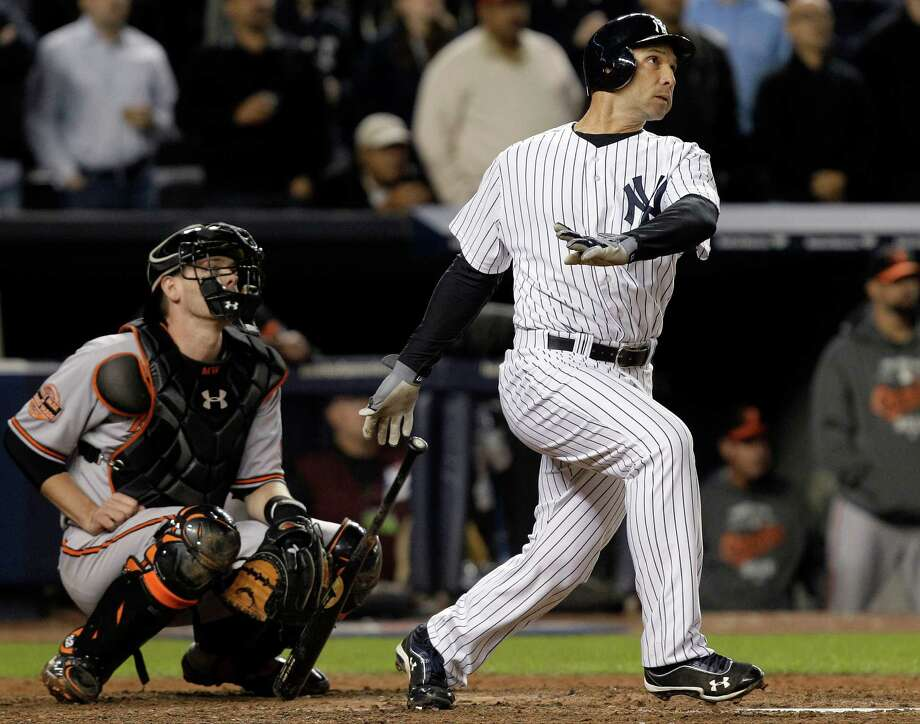 New York Yankees' Raul Ibanez follows through on a home run as Baltimore Orioles catcher Matt Wieters watches during the ninth inning of Game 3 of the American League division baseball series Wednesday, Oct. 10, 2012, in New York. (AP Photo/Kathy Willens) Photo: Kathy Willens