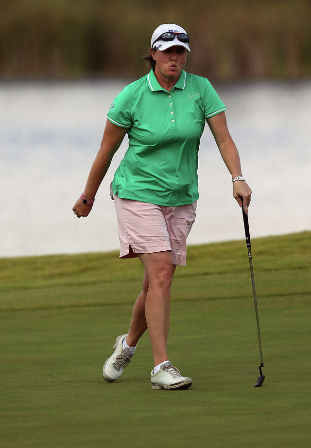 Stacy Dennis of Huntsville, Texas reacts after putt on No. 6 during her match against Liz Waynick at the U.S. Women's Mid-Amateur Championships quarterfinals at Briggs Ranch Golf Club on Wednesday, Oct. 10, 2012. Photo: Kin Man Hui, Express-News / ©2012 San Antonio Express-News