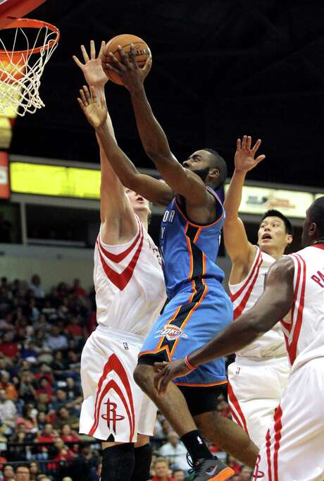 The Rockets had to deal with James Harden, center, as an opponent in an Oct. 10 preseason game against Oklahoma City. Now they have to figure out how to work Harden and two other players acquired in Saturday's trade with the Thunder into the lineup mix before Wednesday's season opener. Photo: Delcia Lopez, FRE / FRE18466 AP