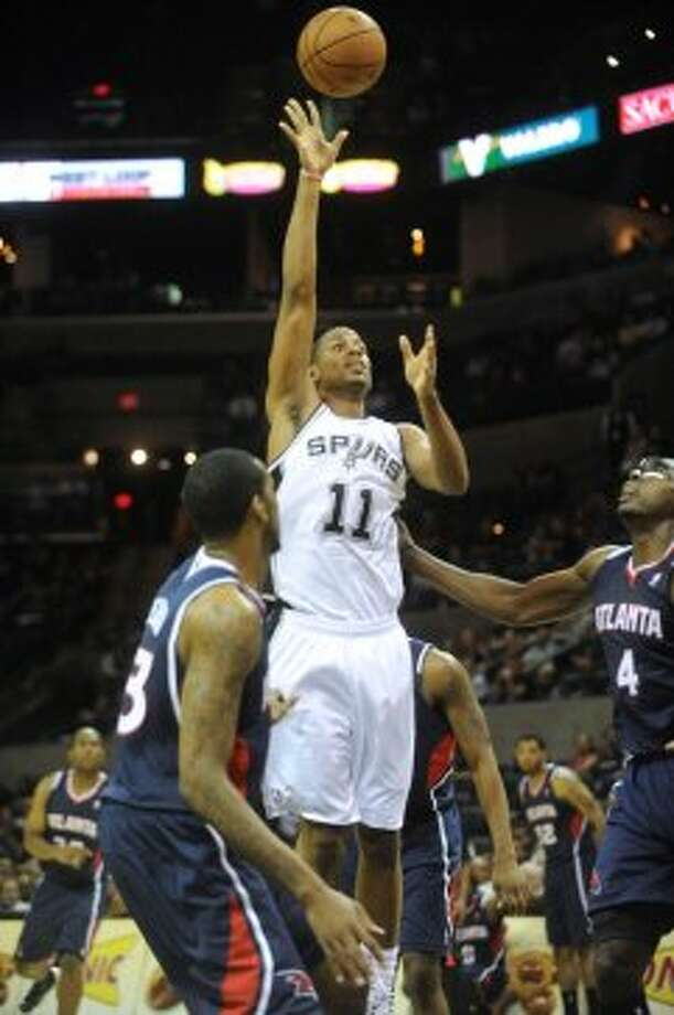Wesley Witherspoon of the Spurs shoots against Atlanta during preseason NBA action at the AT&T Center on Wednesday, Oct. 10, 2012. (Billy Calzada / San Antonio Express-News)