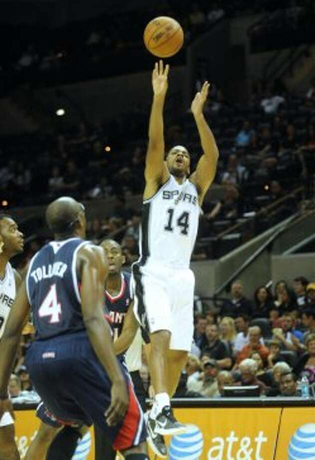 Gary Neal of the Spurs hoots against Atlanta during preseason NBA action at the AT&T Center on Wednesday, Oct. 10, 2012. (Billy Calzada / San Antonio Express-News)