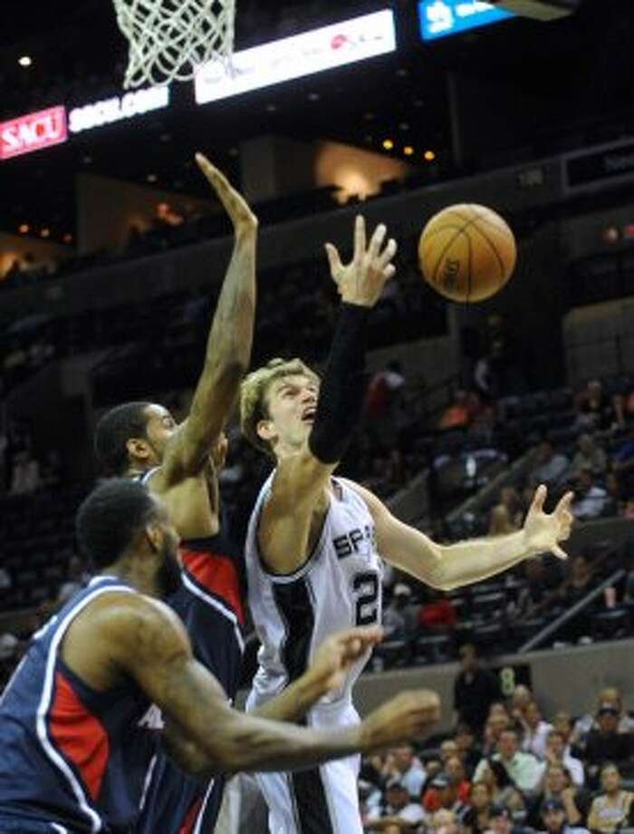 Tiago Splitter of the Spurs battles the Atlanta Hawks for the ball during preseason NBA action at the AT&T Center on Wednesday, Oct. 10, 2012. (Billy Calzada / San Antonio Express-News)