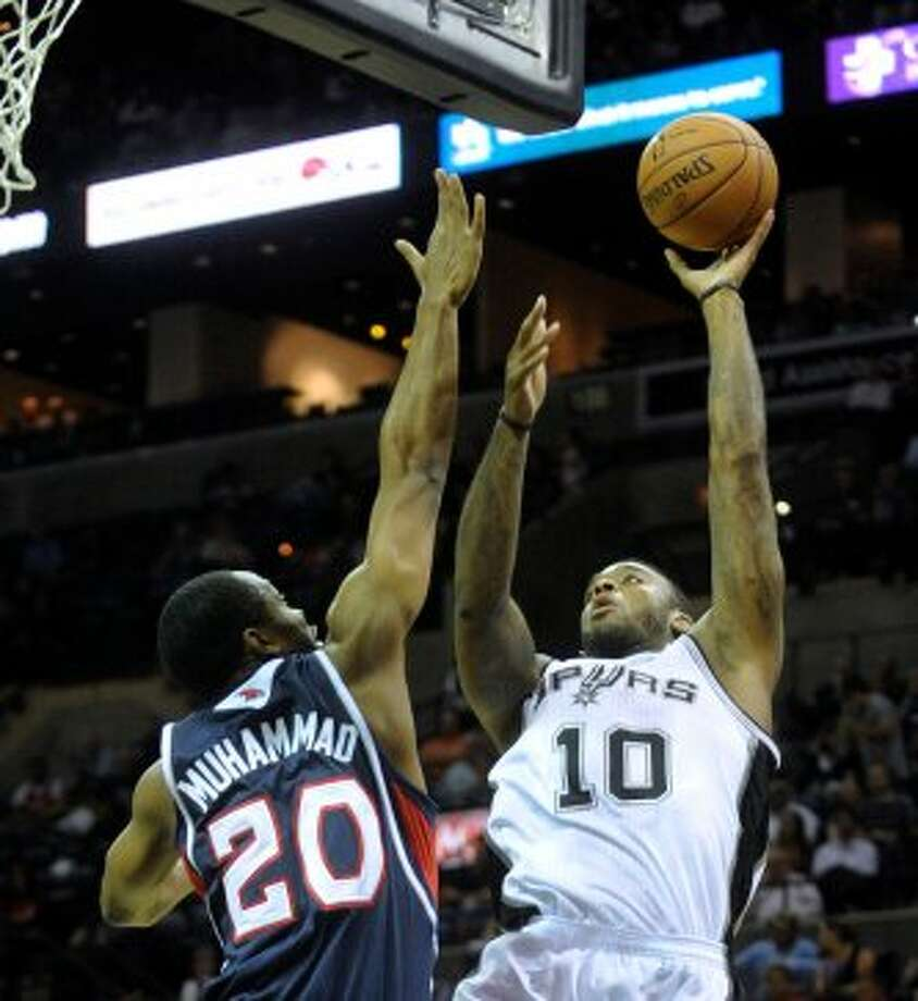 Josh Powell of the Spurs shoots over Isma'il Muhammad of Atlanta during preseason NBA action at the AT&T Center on Wednesday, Oct. 10, 2012. (Billy Calzada / San Antonio Express-News)
