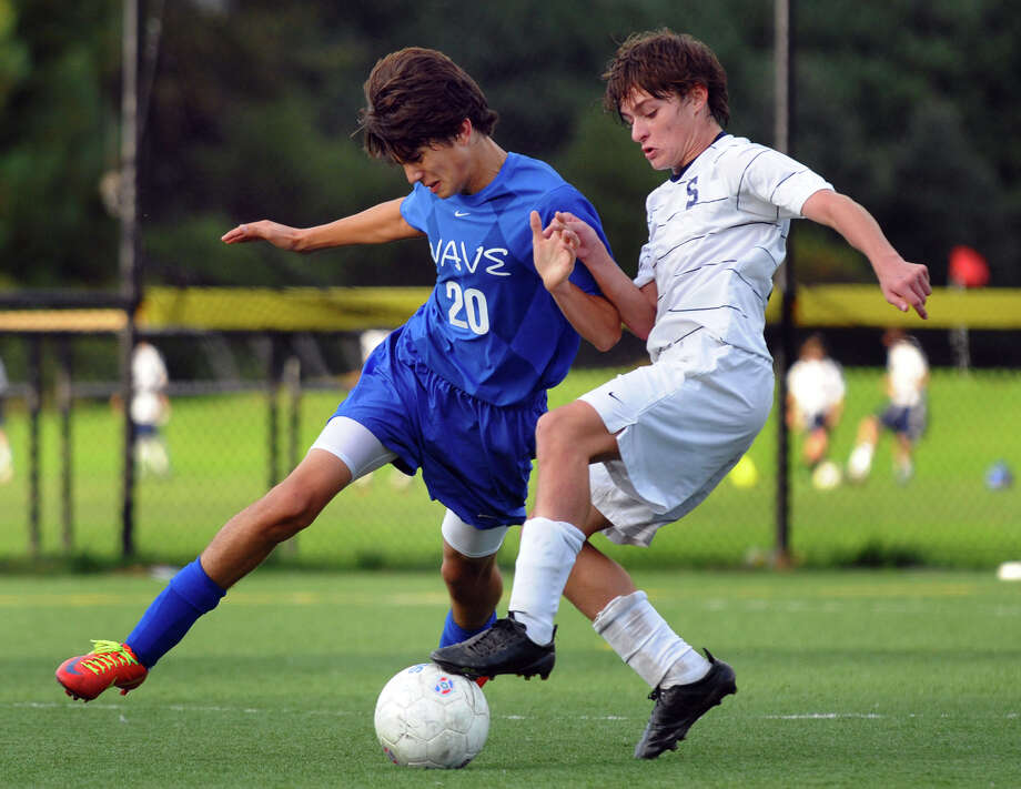 Staples #29 Gregory Shikowitz, right, and Darien's #20 Andrew Matthew struggle to control the ball, during boys soccer action in Westport, Conn. on Wedesday October 10, 2012. Photo: Christian Abraham