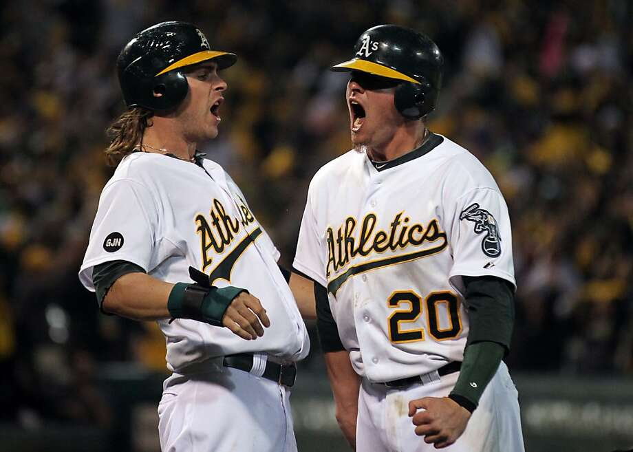 Oakland Athletics Josh Reddick and Josh Donaldson celebrate after they both scored the tieing runs on a Seth Smith double in the 9th inning against Detroit Tigers in their ALDS game Wednesday October 10, 2012 in Oakland California Photo: Lance Iversen, The Chronicle