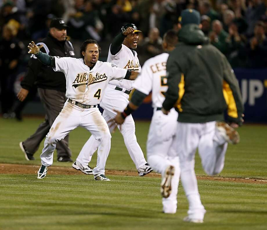 Oakland Athletics' Coco Crisp celebrates after he hit a walk-off single to win game four of the American League Divisional Series on Wednesday, October 9, 2012 in Oakland, Calif. Photo: Beck Diefenbach, Special To The Chronicle