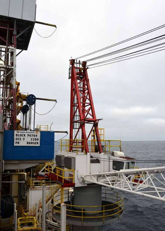 Shown here is one of the two cranes on the drillship Noble Discoverer, which Shell is using to search for oil in the Chukchi Sea north of Alaska. The cranes can't be used once the temperature dips below 0 degrees celsius -- a challenge in this chilly, Arctic environment.  (Photo: Jennifer A. Dlouhy / The Houston Chronicle) (Jennifer A. Dlouhy)