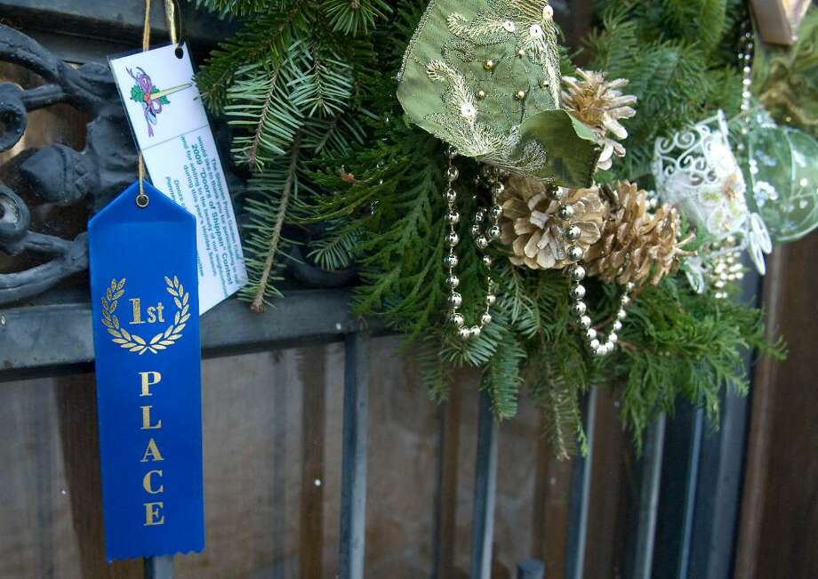 Members of the Shippan Garden Club judge the Doors of Shippan competition  in Stamford,  Conn. on Thursay, December 10,  2009. Photo: Kathleen O'Rourke / Stamford Advocate