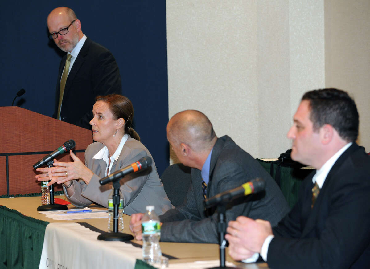 """Panelist Kate Breslin, president and CEO of the not-for-profit Schuyler Center for Analysis and Advocacy speaks during a discussion of the new federal Affordable Care Act at the NYS Nurses Association Wednesday, Oct. 10, 2012 in Colonie, N.Y. Also on the panel was Richard Kirsch, second from right, a senior fellow at the Rockefeller Institute and author the book """"Fighting for Our Health: The Epic Battle to Make Health Care a Right in the United States;"""" and Lev Ginsburg, director of government affairs at the Business Council of New York State. The panel was moderated by Casey Seiler, left, state editor for the Albany Times Union and the event was sponsored by Women@Work, a special publication of the Times Union geared toward women business leaders. (Lori Van Buren / Times Union)"""