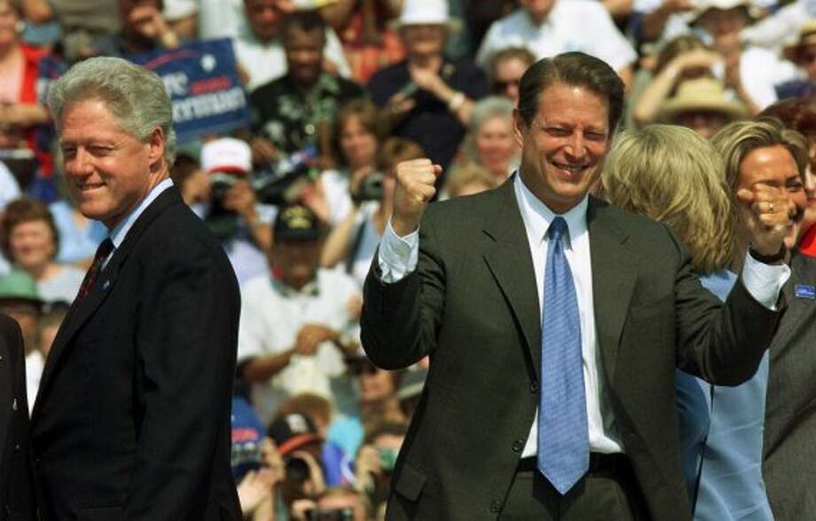 Democratic presidential hopeful Vice President Al Gore pumps his fist as President Clinton during a campaign at rally in Monroe, Mich., Tuesday, Aug. 15, 2000. 'Bill Clinton worked hard to get the economy right,' Gore said. 'I'm not going to let the other side wreck it.' (AP Photo/Doug Mills)  HOUCHRON CAPTION (08/16/2000):  Vice President Al Gore pumps his fists as he and President Clinton appear at a campaign rally Tuesday in the working-class community of Monroe, Mich.,  for a symbolic passing of the torch. (AP)
