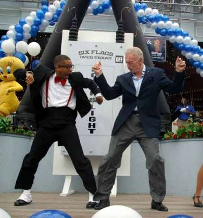 "Dallas Cowboy's owner Jerry Jones, right, dances with Jason Johnson of the ""It's Playtime Dancer's"" during a ceremony honoring Jones as General Manager of the Day at Six Flags Over Texas amusement park season's opening day in Arlington, Texas, Saturday, March 5, 2005. Arlington is the future home of the Cowboy's new stadium set to open for the 2009 season. (AP Photo/Six Flags Over Texas, Jerry W. Hoefer) (JERRY W. HOEFER / AP)"