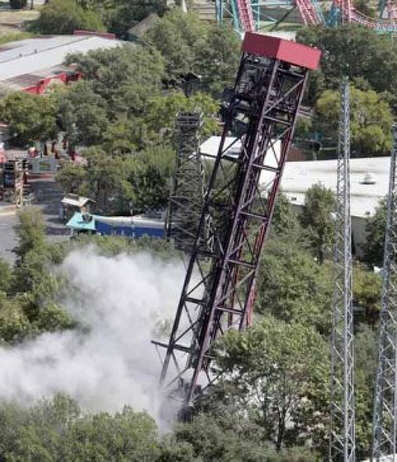 The 25-year-old Wildcatter ride at Six Flags Over Texas in Arlington, Texas, begins to fall after is was imploded Tuesday, Oct. 2, 2007. The ride was knocked over to make room for the construction of Tony Hawk's Big Spin ride. (AP Photo) (AP)