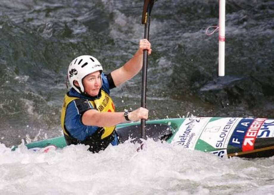 Marian Davidson digs in with her paddle, straining to make it through the final gate of the womens' K1 whitewater slalom course at the Southwest Regional Olympic team trials at Six Flags over Texas in Arlington, Texas, Sunday afternoon, March 5, 2000. (AP Photo/Fort Worth Star-Telegram, Darrell Byers) (DARRELL BYERS / AP)