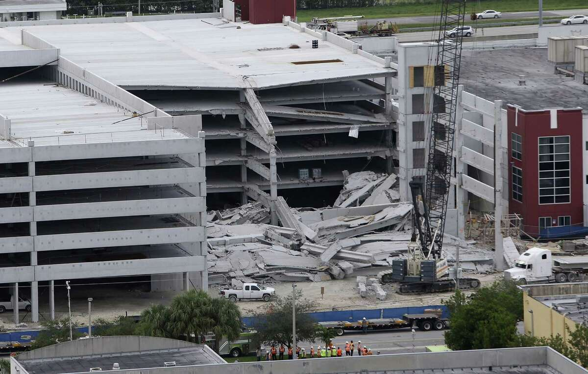 A five-story parking garage is shown after it collapsed at Miami-Dade College, Wednesday, Oct. 10, 2012 in Miami, killing one worker and trapping two others in the rubble, officials said. Several other workers were hurt, including one rescued from the debris. (AP Photo/Lynne Sladky)
