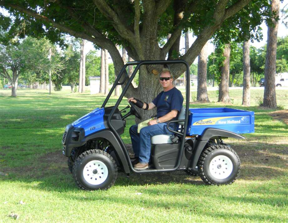 Robert Schulte, assistant chief of the Village of Pleak Volunteer Fire Department, takes the New Holland Rustler 115 Utility side-by-side for a test ride. The vehicle is the top raffle prize in the Oct. 14 fundraiser for the department.
