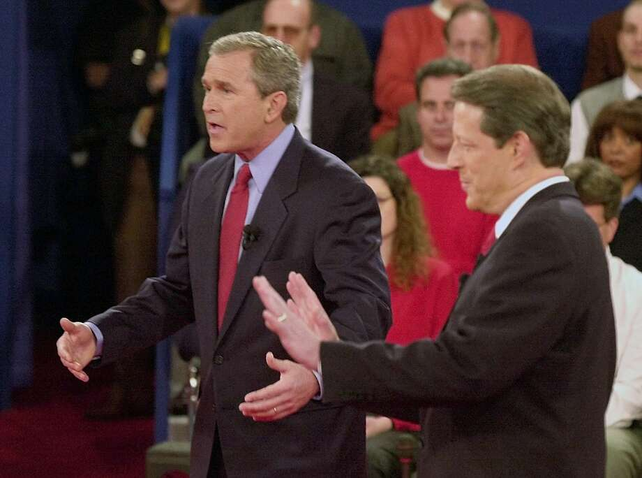 A reader says that Democrats, in their attempt to make excuses for President Obama's poor debate performance, have done everything but blame George W. Bush, shown here in a debate with Al Gore in 2000. Photo: File Photo, Associated Press / AP