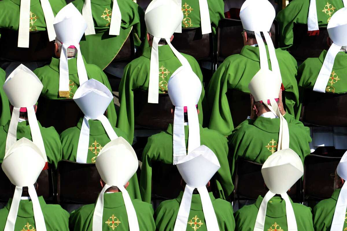 Bishops from around the world seat during a mass led by the pontif to announce a new global