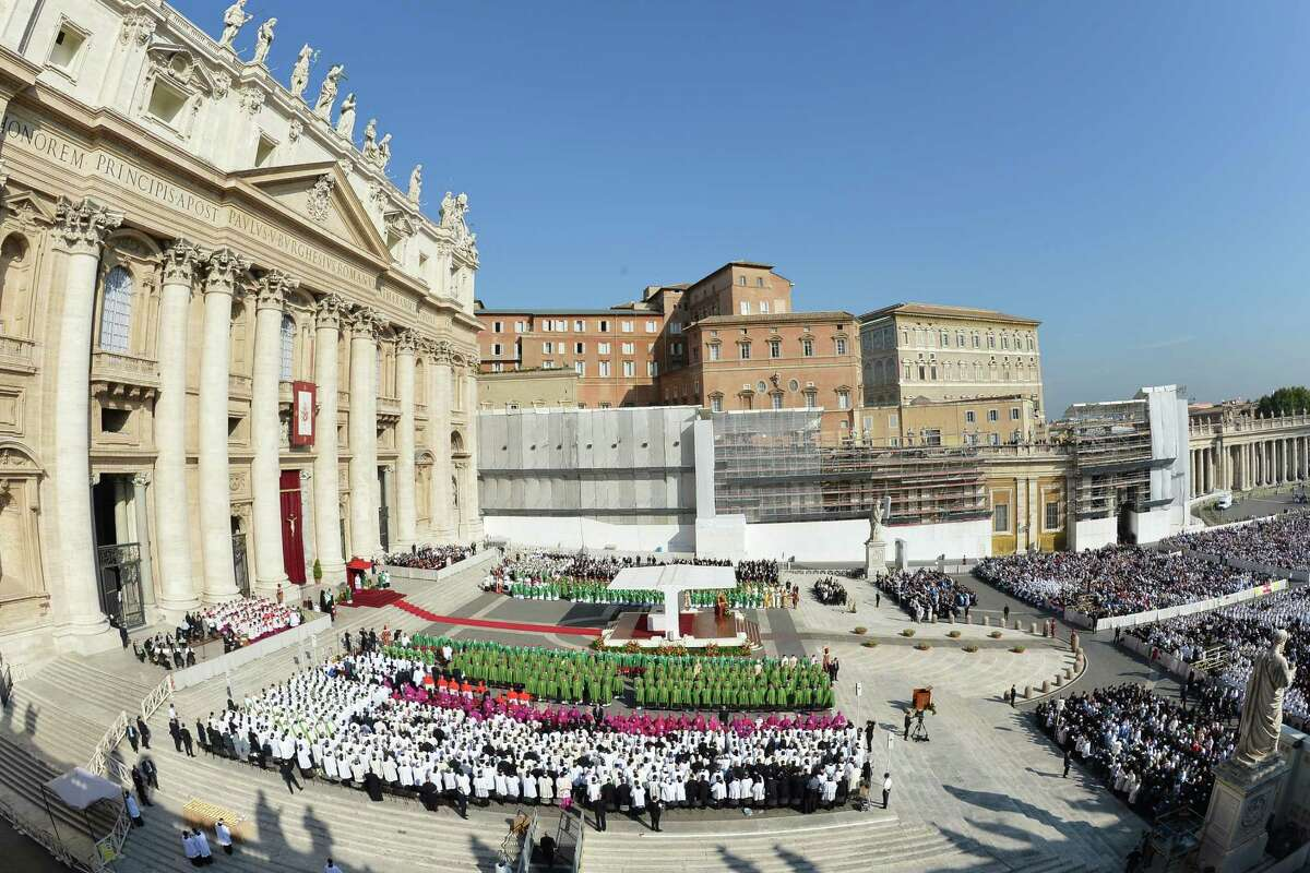 Pope Benedict XVI (C on the altar) leads a mass to announce a new global
