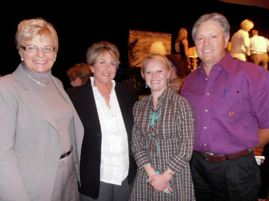 Express-News Book & Author Luncheon founders Karen Norman, from left, and Caroline Walker, gather with cancer survivor and luncheon speaker Terra Bibb and her father Terry Eoff at the event benefiting the CTRC's Phase I Clinical Research Program. Photo: San Antonio Express-News