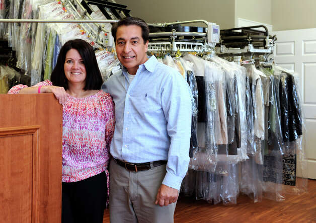 Fatima and Angelo DaCunha, owners of Brookfield Cleaners & Tailors, at 28 Old Route 7 in Brookfield, are photographed Thursday, Oct. 11, 2012. Photo: Carol Kaliff