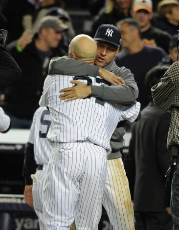 New York Yankees celebrate after Raul Ibanez (27) game winning home run in the 12th inning on the Yankees 3-2 win. Game 3 of the ALDS between the New York Yankees and the Baltimore Orioles at Yankee Stadium. (Ron Antonelli/ New York Daily News)New York Yankees shortstop Derek Jeter (2) hugs  Raul Ibanez (27) after his game winning home run in the 12th inning on the Yankees 3-2 win. Game 3 of the ALDS between the New York Yankees and the Baltimore Orioles at Yankee Stadium. Photo: Ron Antonelli, New York Daily News / 2012/Daily News, L.P. (New York)