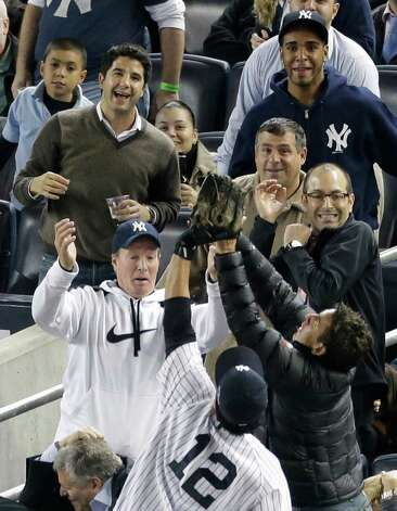 New York Yankees' Eric Chavez competes with fans as he catches a foul ball hit by Baltimore Orioles' Manny Machado in the seventh inning in Game 3 of the American League division baseball series, Wednesday, Oct. 10, 2012, in New York. Photo: Peter Morgan, AP / AP
