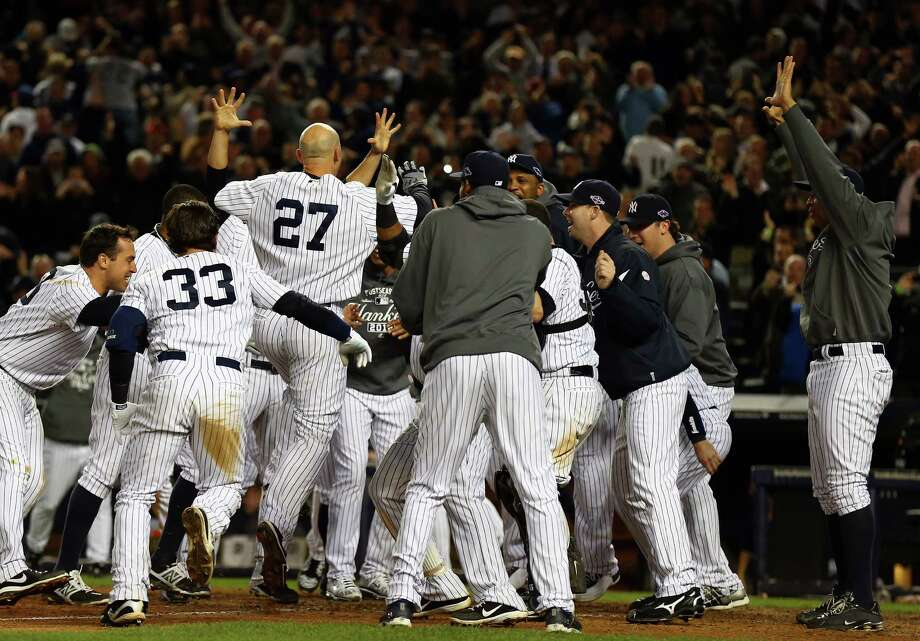 NEW YORK, NY - OCTOBER 10:  Raul Ibanez #27 of the New York Yankees reacts after hitting a walk off home run in the bottom of the twelfth inning to defeat the Baltimore Orioles  in Game Three of the American League Division Series at Yankee Stadium on October 10, 2012 in the Bronx borough of New York City. Photo: Elsa, Getty Images / 2012 Getty Images