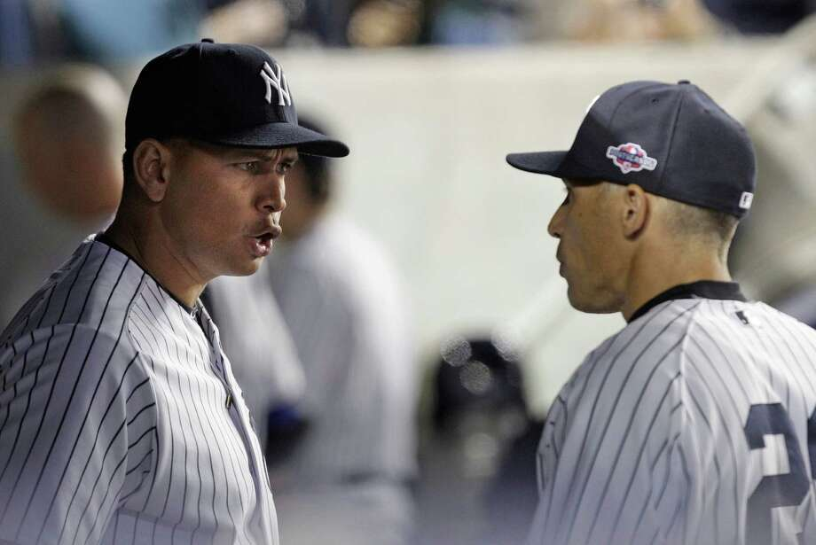 New York Yankees' Alex Rodriguez, left, talks to manager Joe Girardi during the 10th inning of Game 3 against the Baltimore Orioles in the American League division baseball series Wednesday, Oct. 10, 2012, in New York. The Yankees won 3-2. Photo: Kathy Willens, AP / AP