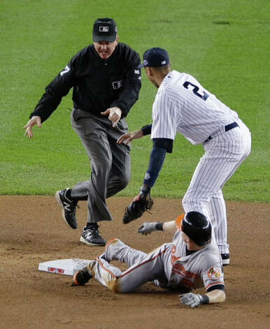 New York Yankees' Derek Jeter, right, and Baltimore Orioles' Nate McLouth watch as second base umpire Mike Everitt calls McLouth out on an attempted steal in the first inning in Game 3 of the American League division baseball series, Wednesday, Oct. 10, 2012, in New York. Photo: Peter Morgan, AP / AP