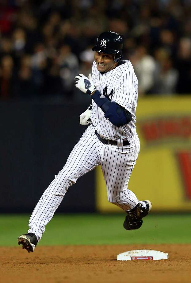NEW YORK, NY - OCTOBER 10: Derek Jeter #2 of the New York Yankees rounds second base after hitting a triple against the Baltimore Orioles  during Game Three of the American League Division Series at Yankee Stadium on October 10, 2012 in the Bronx borough of New York City. Photo: Elsa, Getty Images / 2012 Getty Images