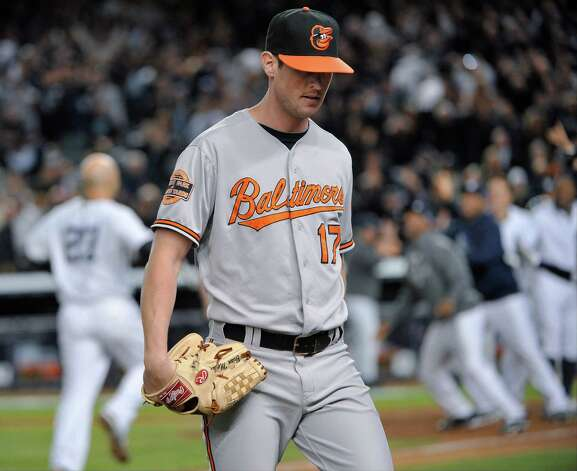 Baltimore Orioles pitcher Brian Matusz leaves the field as New York Yankees' Raul Ibanez (27) approaches home plate after hitting the game-winning home run in the 12th inning of Game 3 of the American League division baseball series Wednesday, Oct. 10, 2012, in New York. The Yankees won 3-2. Photo: Bill Kostroun, AP / FR59151 AP