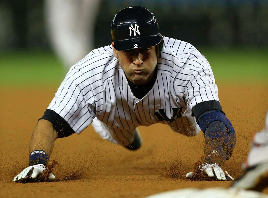 NEW YORK, NY - OCTOBER 10:  Derek Jeter #2 of the New York Yankees slides into third base against the Baltimore Orioles  during Game Three of the American League Division Series at Yankee Stadium on October 10, 2012 in the Bronx borough of New York City. Photo: Elsa, Getty Images / 2012 Getty Images