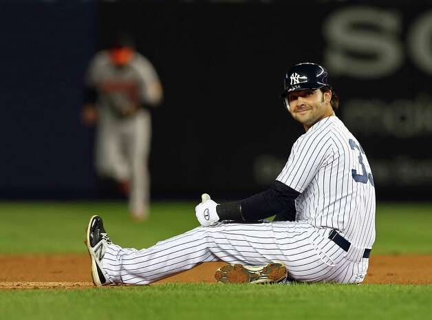 NEW YORK, NY - OCTOBER 10: Nick Swisher #33 of the New York Yankees looks on after an out against the Baltimore Orioles during Game Three of the American League Division Series at Yankee Stadium on October 10, 2012 in the Bronx borough of New York City. Photo: Elsa, Getty Images / 2012 Getty Images