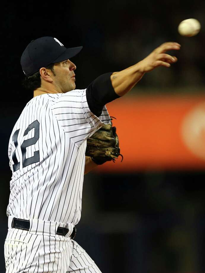 NEW YORK, NY - OCTOBER 10: Eric Chavez #12 of the New York Yankees throws the ball to first base to end the sixth inning of Game Three of the American League Division Series against the Baltimore Orioles at Yankee Stadium on October 10, 2012 in the Bronx borough of New York City. Photo: Elsa, Getty Images / 2012 Getty Images