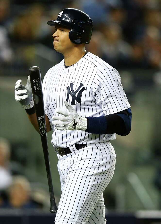 NEW YORK, NY - OCTOBER 10: Alex Rodriguez #13 of the New York Yankees reacts after striking out  during Game Three of the American League Division Series against the Baltimore Orioles at Yankee Stadium on October 10, 2012 in the Bronx borough of New York City. Photo: Al Bello, Getty Images / 2012 Getty Images