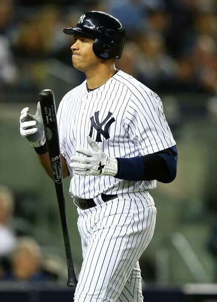 NEW YORK, NY - OCTOBER 10: Alex Rodriguez #13 of the New York Yankees reacts after striking out  dur