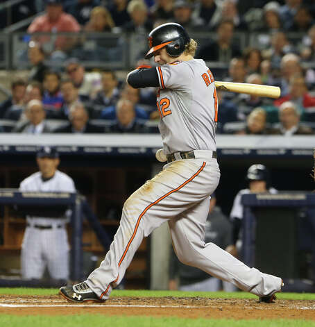 Baltimore Orioles third baseman Mark Reynolds is hit by a pitch in the fourth inning of game three of the American League Division Series against the New York Yankees at Yankee Stadium in New York, Oct. 10, 2012. (Chang W. Lee/The New York Times) Photo: CHANG W. LEE, NYT / NYTNS