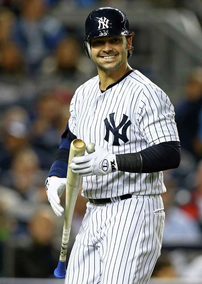 NEW YORK, NY - OCTOBER 10:  Nick Swisher #33 of the New York Yankees reacts after striking out  during Game Three of the American League Division Series against the Baltimore Orioles at Yankee Stadium on October 10, 2012 in the Bronx borough of New York City. Photo: Al Bello, Getty Images / 2012 Getty Images