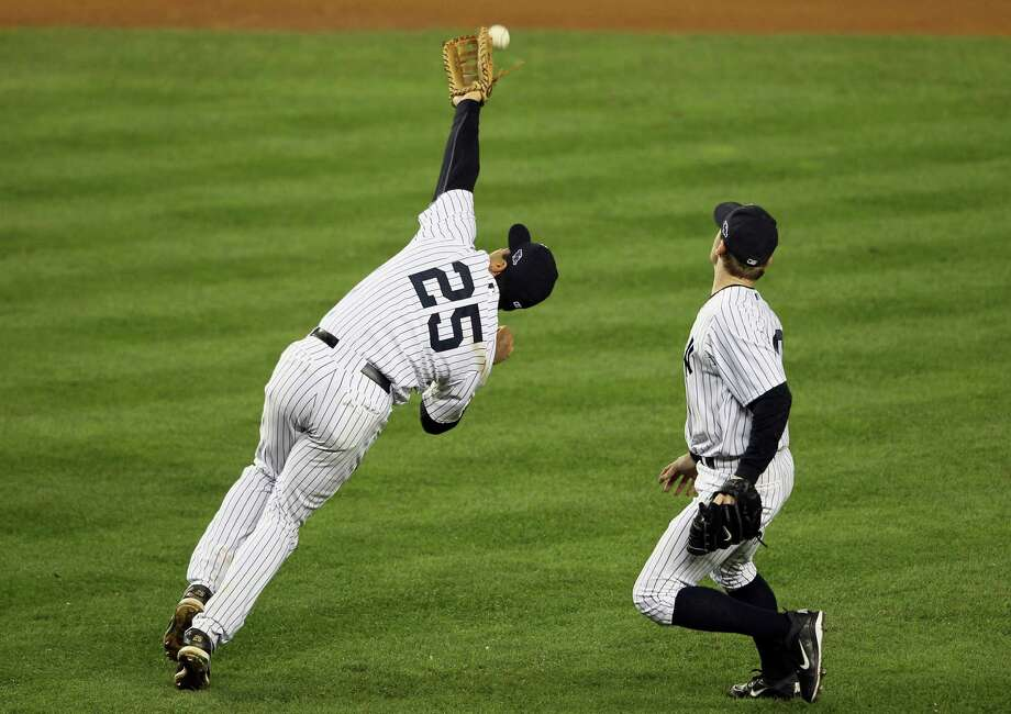 NEW YORK, NY - OCTOBER 10:  Mark Teixeira #25 of the New York Yankees miscommunicates with David Robertson #30 and misses a catch in the top of the twelfth inning during Game Three of the American League Division Series against the Baltimore Orioles at Yankee Stadium on October 10, 2012 in the Bronx borough of New York City. Photo: Alex Trautwig, Getty Images / 2012 Getty Images