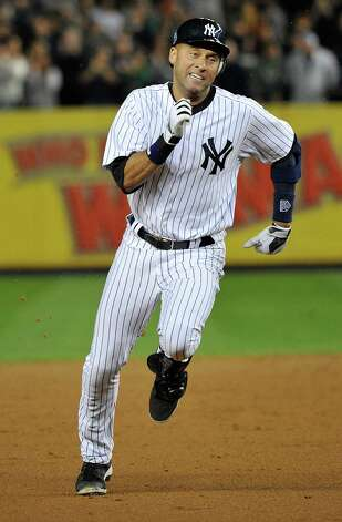 New York Yankees' Derek Jeter runs to third base for a triple during the third inning of Game 3 of the American League division baseball series against the Baltimore Orioles Wednesday, Oct. 10, 2012, in New York. Raul Ibanez lined a tying home run while pinch hitting for slumping Alex Rodriguez in the ninth inning, then hit a leadoff homer in the 12th, giving the New York Yankees a stunning 3-2 win over the Baltimore Orioles on Wednesday night for a 2-1 lead in their AL division series. Photo: Bill Kostroun, AP / FR59151 AP
