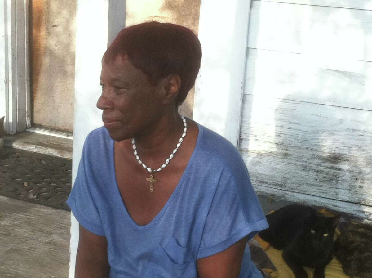 Creola Scott sits on her front porch talking about the confrontation between an HPD officer and her neighbor that left the man fatally shot about 12:10 a.m. Thursday in the 3300 block of Sampson. (HC/Dale Lezon)