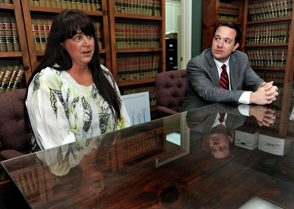 Judge Bob Wortham decided Wednesday to sanction Bank of America to pay $300,000 to Trudie Crutchfield, left, from her lawsuit stemming from payments on her Fannett home. Wyatt Snider, right, said if the mortgage company fails to adhere to the sanction, Crutchfield could be entitled to an addition $600,000. Photo taken Guiseppe Barranco/The Enterprise